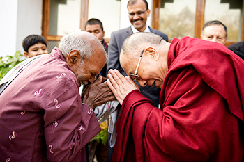 his_holiness-with-disabled_indian_person in Delhi